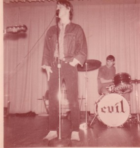 John Doyle, frontman of the band Evil... with drummer Doug Romanella in the background
